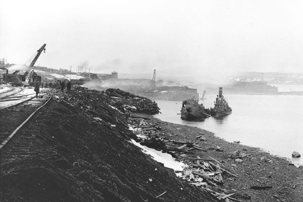 1917 Halifax Explosion image of destroyed ships and land.