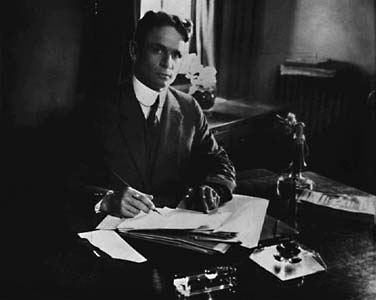 John Bracken writing a book at his desk