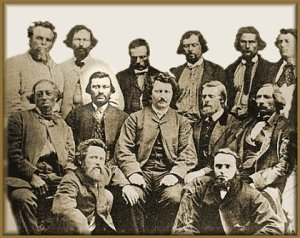 John Bruce (Jean Brousse) sits to the right of Louis Riel