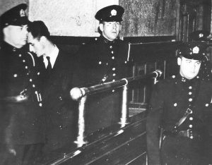 Image of Joseph Guay with police officers