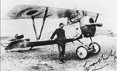 William Billy Bishop leaning on airplane