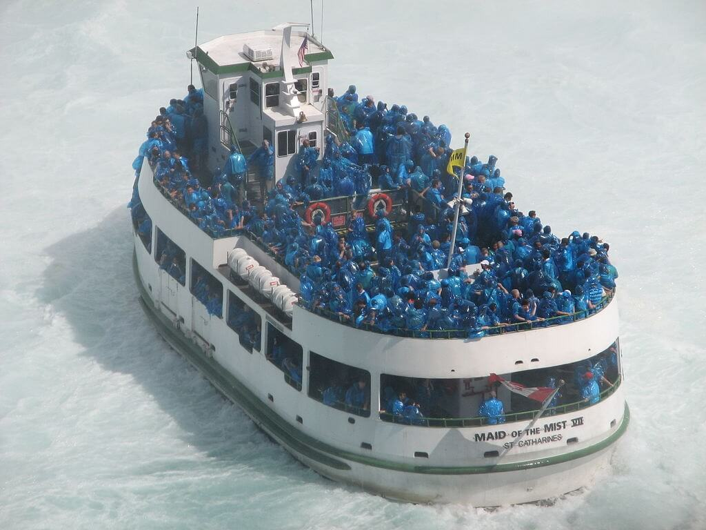 Blue poncho-clad tourists on the Maid of the Mist.