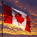 Canadian Flag at sunset in breeze.