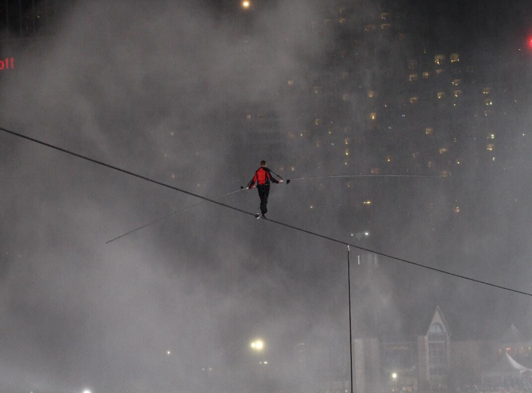 Nik Wallenda walking tight rope over Niagara Falls.