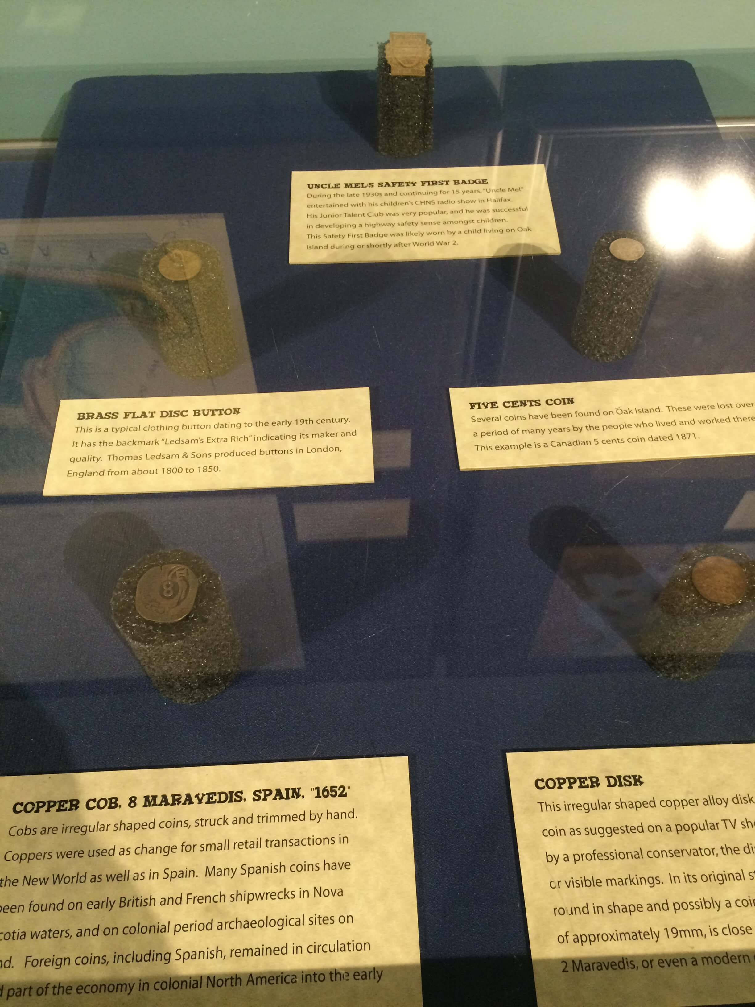 Coins, including a Spanish 8 maravedis, on display at Halifax's Museum of Natural History. Image courtesy of Ryan Phillips.